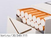 Купить «Box of cigarettes», фото № 30549111, снято 6 сентября 2014 г. (c) Tryapitsyn Sergiy / Фотобанк Лори