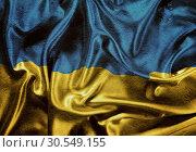 Купить «Grunge Ukraine waving flag», фото № 30549155, снято 24 октября 2012 г. (c) Tryapitsyn Sergiy / Фотобанк Лори