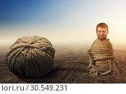 Man in captivity of threads. Стоковое фото, фотограф Tryapitsyn Sergiy / Фотобанк Лори