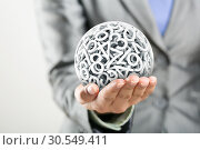Numbers forming a sphere on the women's hand. Стоковое фото, фотограф Tryapitsyn Sergiy / Фотобанк Лори