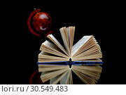 Купить «Open book on a black background», фото № 30549483, снято 18 января 2013 г. (c) Ласточкин Евгений / Фотобанк Лори