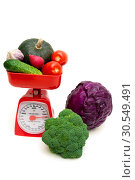 Купить «Vegetables and kitchen scales isolated on white background», фото № 30549491, снято 18 сентября 2013 г. (c) Ласточкин Евгений / Фотобанк Лори