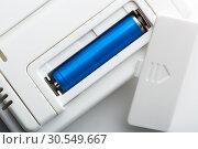 Купить «Blue battery in the socket», фото № 30549667, снято 24 октября 2014 г. (c) Tryapitsyn Sergiy / Фотобанк Лори