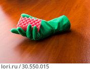 Купить «Green cleaning glove with a sponge», фото № 30550015, снято 12 ноября 2014 г. (c) Tryapitsyn Sergiy / Фотобанк Лори