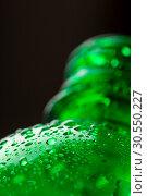 Купить «Drops on green bottle», фото № 30550227, снято 19 ноября 2014 г. (c) Tryapitsyn Sergiy / Фотобанк Лори