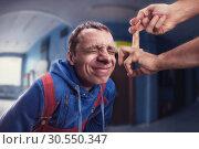 Fillip on man's forehead. Стоковое фото, фотограф Tryapitsyn Sergiy / Фотобанк Лори