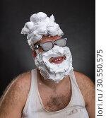 Strange smiling man in glasses. Стоковое фото, фотограф Tryapitsyn Sergiy / Фотобанк Лори