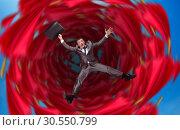 Businessman falls into abyss. Стоковое фото, фотограф Tryapitsyn Sergiy / Фотобанк Лори