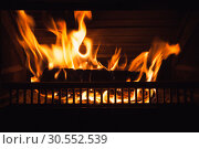 Купить «Firewood burns at night, close up», фото № 30552539, снято 26 января 2019 г. (c) EugeneSergeev / Фотобанк Лори