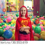 Купить «Smiling little girl in costume», фото № 30553619, снято 8 августа 2015 г. (c) Tryapitsyn Sergiy / Фотобанк Лори