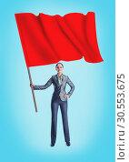 Купить «Woman holding a red flag», фото № 30553675, снято 19 сентября 2019 г. (c) Tryapitsyn Sergiy / Фотобанк Лори