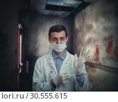 Купить «Doctor bloodstained», фото № 30555615, снято 10 июня 2016 г. (c) Tryapitsyn Sergiy / Фотобанк Лори
