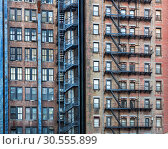 Купить «Facade of old red building.», фото № 30555899, снято 8 июня 2016 г. (c) Tryapitsyn Sergiy / Фотобанк Лори