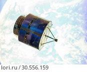 Купить «Satellite in space orbit», фото № 30556159, снято 12 июня 2016 г. (c) Tryapitsyn Sergiy / Фотобанк Лори