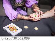 Купить «Sorceress reading somebody's hand», фото № 30562099, снято 27 июля 2016 г. (c) Tryapitsyn Sergiy / Фотобанк Лори