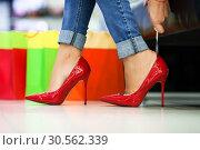 Купить «Woman fitting stilettos», фото № 30562339, снято 9 сентября 2016 г. (c) Tryapitsyn Sergiy / Фотобанк Лори