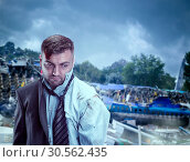 Купить «Man after wreckage», фото № 30562435, снято 7 июля 2016 г. (c) Tryapitsyn Sergiy / Фотобанк Лори