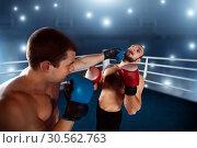 Купить «Boxer sents his opponent to the knockout.», фото № 30562763, снято 7 октября 2016 г. (c) Tryapitsyn Sergiy / Фотобанк Лори