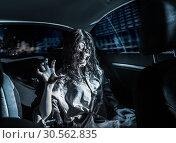 Купить «Horror zombie woman with bloody face in the car», фото № 30562835, снято 8 октября 2016 г. (c) Tryapitsyn Sergiy / Фотобанк Лори