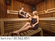Two young and happy females in sauna. Стоковое фото, фотограф Tryapitsyn Sergiy / Фотобанк Лори