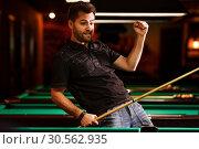 Купить «Player glad that has hammered a difficult sphere.», фото № 30562935, снято 18 октября 2016 г. (c) Tryapitsyn Sergiy / Фотобанк Лори
