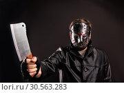 Купить «Murderer in hockey mask with meat cleaver in hand», фото № 30563283, снято 7 ноября 2016 г. (c) Tryapitsyn Sergiy / Фотобанк Лори