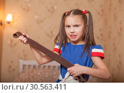 Купить «Angry little girl with belt in hand.», фото № 30563411, снято 24 ноября 2016 г. (c) Tryapitsyn Sergiy / Фотобанк Лори