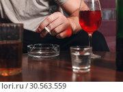 Купить «Drunk man with cigarette in hand.», фото № 30563559, снято 24 ноября 2016 г. (c) Tryapitsyn Sergiy / Фотобанк Лори