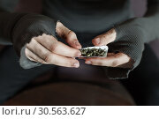 Купить «Addict hands making marijuana jamb closeup.», фото № 30563627, снято 25 ноября 2016 г. (c) Tryapitsyn Sergiy / Фотобанк Лори