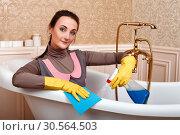 Female cleaning servisce worker sitting in bath. Стоковое фото, фотограф Tryapitsyn Sergiy / Фотобанк Лори