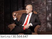 Купить «Killer in suit and tie ready to pull a grenade pin», фото № 30564647, снято 19 января 2017 г. (c) Tryapitsyn Sergiy / Фотобанк Лори