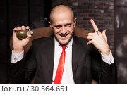 Купить «Killer in suit and tie ready to pull a grenade pin», фото № 30564651, снято 19 января 2017 г. (c) Tryapitsyn Sergiy / Фотобанк Лори