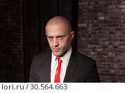 Купить «Contract killer in suit and red tie», фото № 30564663, снято 19 января 2017 г. (c) Tryapitsyn Sergiy / Фотобанк Лори