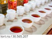 Купить «Ceylon tea degustation cups closeup view», фото № 30565207, снято 21 февраля 2017 г. (c) Tryapitsyn Sergiy / Фотобанк Лори
