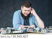 Engineer work with broken computer motherboard. Стоковое фото, фотограф Tryapitsyn Sergiy / Фотобанк Лори
