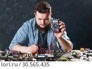 Computer hardware electronic components diagnostic. Стоковое фото, фотограф Tryapitsyn Sergiy / Фотобанк Лори