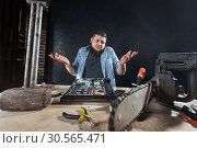 Купить «Repairman fixing problem with computer hardware», фото № 30565471, снято 7 марта 2017 г. (c) Tryapitsyn Sergiy / Фотобанк Лори