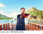 Купить «Male fiddler playing classical music on violin», фото № 30565535, снято 4 марта 2017 г. (c) Tryapitsyn Sergiy / Фотобанк Лори
