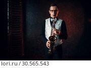 Купить «Male saxophonist playing jazz melody on saxophone», фото № 30565543, снято 4 марта 2017 г. (c) Tryapitsyn Sergiy / Фотобанк Лори