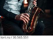 Jazz man hands holding saxophone closeup. Стоковое фото, фотограф Tryapitsyn Sergiy / Фотобанк Лори