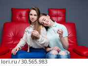 Two girls with cups of coffee sitting together. Стоковое фото, фотограф Tryapitsyn Sergiy / Фотобанк Лори