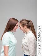Купить «Girls screams at each other, studio photo shoot», фото № 30566027, снято 23 марта 2017 г. (c) Tryapitsyn Sergiy / Фотобанк Лори