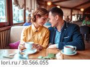 Happy couple, romantic date in restaurant. Стоковое фото, фотограф Tryapitsyn Sergiy / Фотобанк Лори