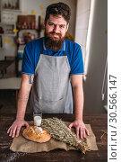 Купить «Baker against bread, wheat, milk on burlap cloth», фото № 30566147, снято 29 марта 2017 г. (c) Tryapitsyn Sergiy / Фотобанк Лори
