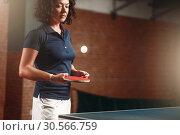 Table tennis, female player with racket hits ball. Стоковое фото, фотограф Tryapitsyn Sergiy / Фотобанк Лори