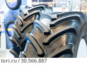 Tractor tires, agricultural machinery rubber tyres. Стоковое фото, фотограф Tryapitsyn Sergiy / Фотобанк Лори