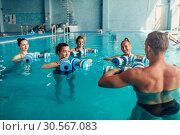 Купить «Women aqua aerobics traninig with dumbbells», фото № 30567083, снято 24 мая 2017 г. (c) Tryapitsyn Sergiy / Фотобанк Лори