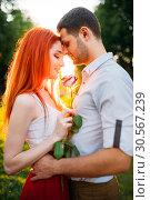 Купить «Beautiful love couple hugs in park on sunset», фото № 30567239, снято 21 июня 2017 г. (c) Tryapitsyn Sergiy / Фотобанк Лори