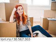 Happy woman among carton boxes, new home. Стоковое фото, фотограф Tryapitsyn Sergiy / Фотобанк Лори