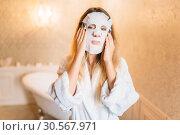Купить «Woman with facial cosmetic mask, skincare», фото № 30567971, снято 3 сентября 2017 г. (c) Tryapitsyn Sergiy / Фотобанк Лори